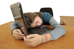 Computer generation. Young girlsleeping in front of a laptop computer Stock Photos