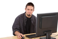 Computer generation. Education, young cheerful Caucasian student and his computer Stock Image