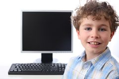 Computer generation. Young boy at the computer Royalty Free Stock Photos