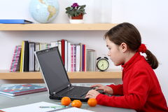 Computer generation. Young girl at the computer Stock Photography