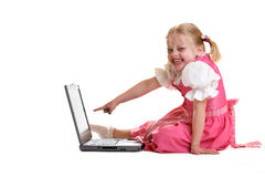 Computer Generation. Young child sitting on computer found someting funny Stock Photo