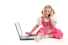 Computer Generation. Child working on computer and having telephone call Stock Photo
