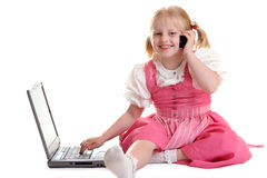 Computer Generation. Child working on computer and having telephone call Stock Images