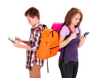 Computer Generation Teens. Kids back to school with tablet and smartphone Stock Image
