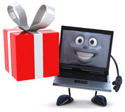 Computer with a gift Royalty Free Stock Image