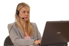 Computer Girl Five. Business lady at computer with headset Stock Image