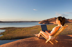 Computer and Girl at Lake Powell Stock Photos
