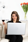 Computer and glass of wine Royalty Free Stock Image