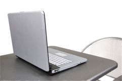 Computer on gray table Royalty Free Stock Photo