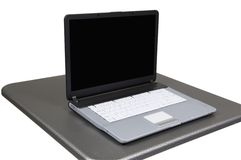 Computer on gray table. Includes path for table and computer together, screen is blank add your own graphic royalty free stock image