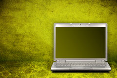 Computer on green background Stock Photos