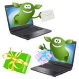 Funny green monsters crawl out of the PC chassis Stock Photo