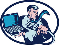 Computer guy cable and laptop Stock Image