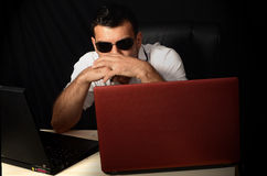 Computer hacker. With laptops and dark glasses Stock Images