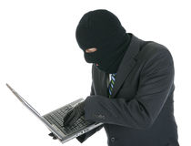 Computer hacker - criminal with the laptop Stock Photo
