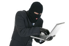 Computer hacker - criminal with the laptop royalty free stock photo