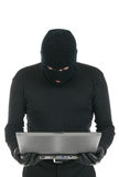 Computer hacker - criminal with the laptop Royalty Free Stock Image