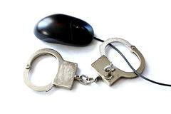 Computer hacker equipment and hand cuffs Stock Image