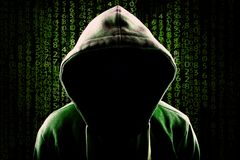Computer Hacker Faceless hooded anonymous programming code background. Computer Hacker. Faceless hooded anonymous against programming code numerical background royalty free stock images