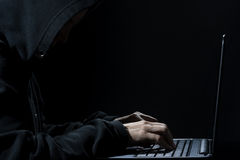 Computer Hacker in Hoodie at Work Stock Images