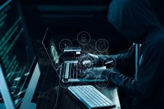 Computer hacker with icons working and stealing information on l Stock Photo