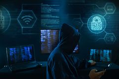 Computer hacker - Internet crime concept with digital interface around stock photo