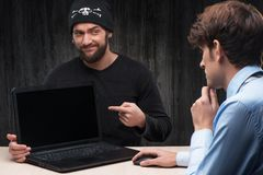Computer hacker introducing laptop with virus Stock Photography