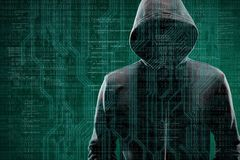 Computer hacker in mask and hoodie over abstract binary background. Obscured dark face. Data thief, internet fraud. Darknet and cyber security concept royalty free stock photo