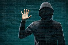 Computer hacker in mask and hoodie over abstract binary background. Obscured dark face. Data thief, internet fraud. Darknet and cyber security concept royalty free stock photography