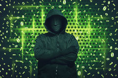 Computer hacker with mask standing royalty free stock image