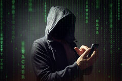 Computer hacker with mobile phone stock photo
