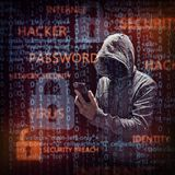 Computer hacker with mobile phone royalty free stock photo