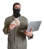 Computer hacker with stolen money Royalty Free Stock Image