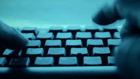 Computer hacker typing code on keyboard, cyber criminals. Hands typing on desktop pc computer keyboard stock footage