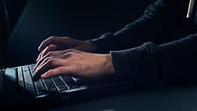 Computer hacker typing on keyboard Royalty Free Stock Photos