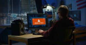 Computer hacker using his computer. Medium shot of a computer hacker using his computer stock video