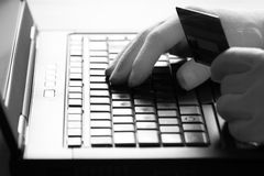 Computer hacker in white gloves stealing information on laptop Stock Images