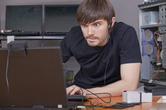 Computer hacker at work Stock Photos