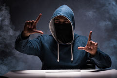The computer hacker working in dark room Royalty Free Stock Photography