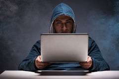 The computer hacker working in dark room Stock Photo