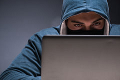 The computer hacker working in dark room Royalty Free Stock Images