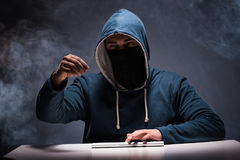 The computer hacker working in dark room Royalty Free Stock Image