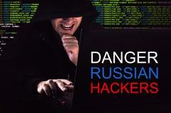 Computer hacker working in dark room Stock Images