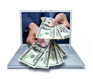 Computer Hand Money Business Services. Cyber cash money coming out of a laptop computer royalty free stock photography