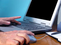 Computer hands. Hand working on a computer...focus on the distance hand Royalty Free Stock Photo