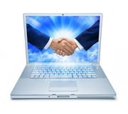 Computer Handshake Marketing Technology. An isolated laptop computer with two businessmen shaking hands Royalty Free Stock Photos