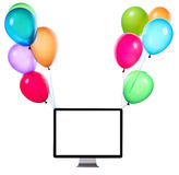 Computer hanging on color balloons Royalty Free Stock Photo