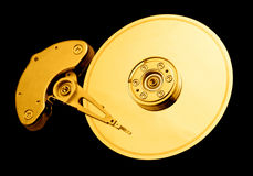 Computer hard Disk Drive. Open hard disk drive, with a golden tone Royalty Free Stock Photos