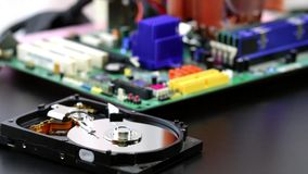 Computer hard disk drive spinning, reading and writing data, stock footage. Computer hard disk drive spinning, reading and writing data, stock footage stock video