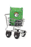 Computer hard disk in mini shopping cart Royalty Free Stock Image